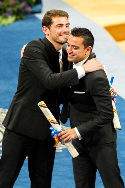 Prince of Asturias prize winners for Sports, Real Madrid soccer player Iker Casillas embraces FC Barcelona soccer player Xavi Hernandez