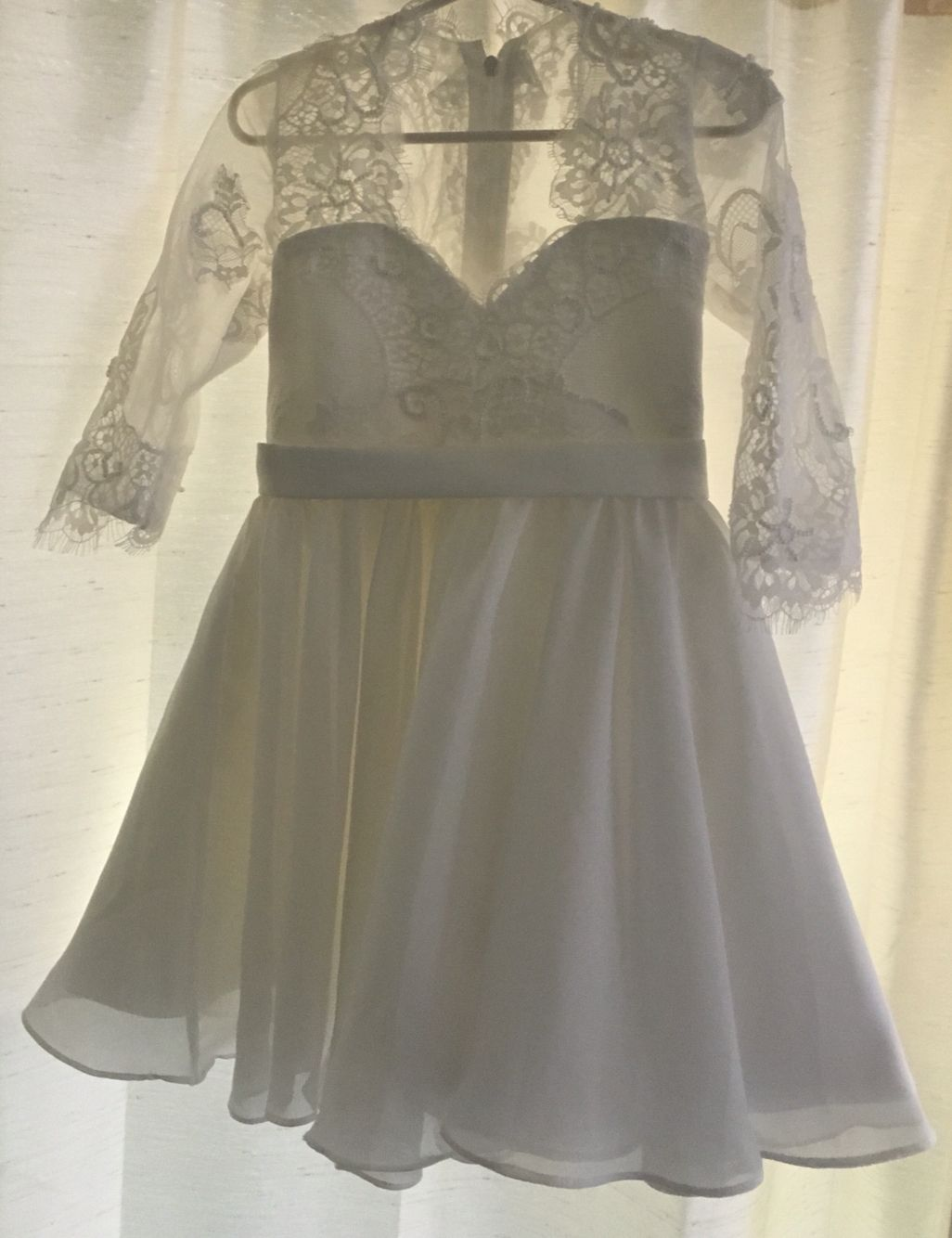 This custom lace flower girlus dress was made to match the brideus