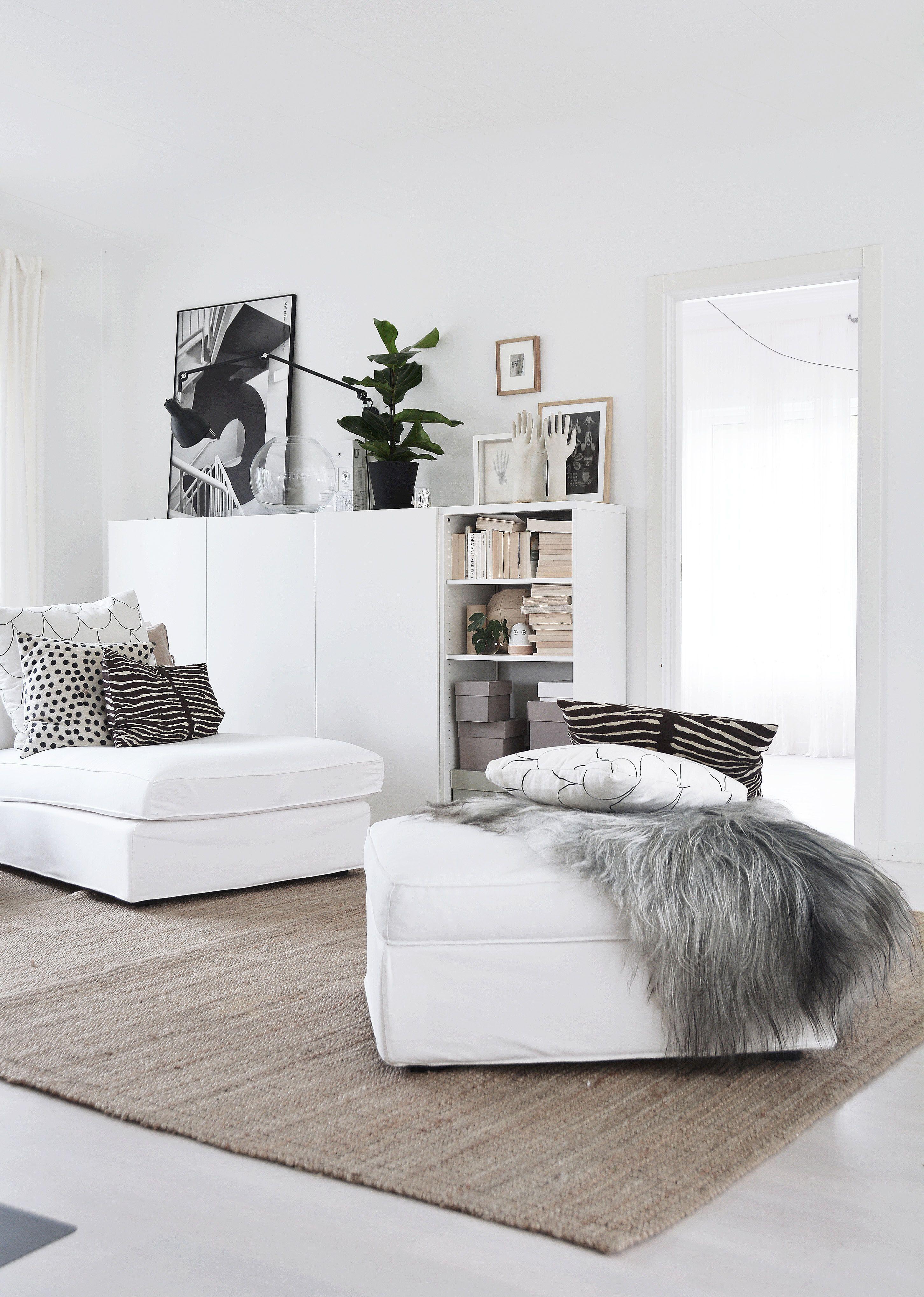 neutral rug + white sofa + white cabinetry