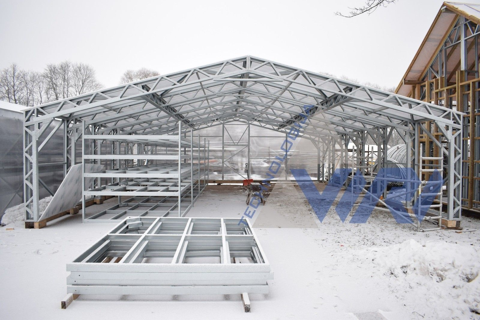 Light Steel Frame Greenhouse A Green House Is Typically A Glass Building In Which Plants That Ne Steel Structure Buildings Steel Frame Steel Frame Construction