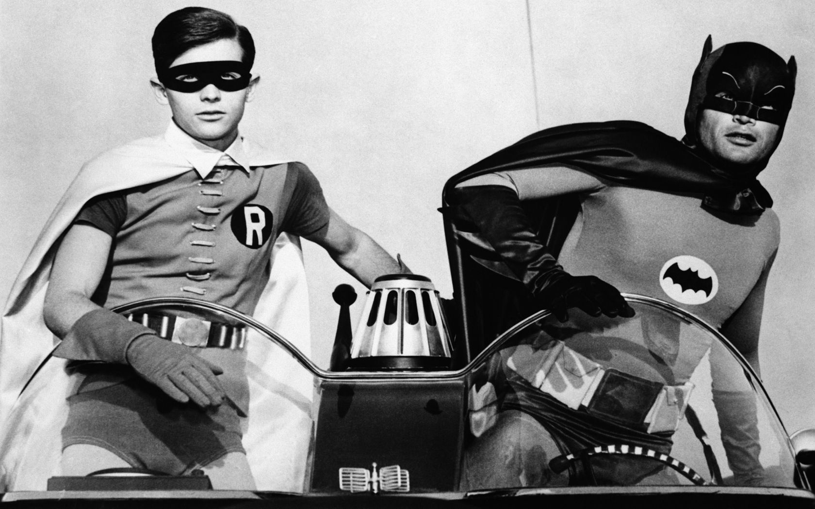 Adam west and burt ward as batman and robin in the 1960s for Black and white shows