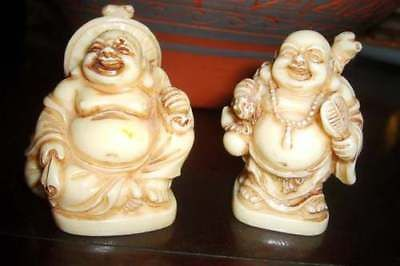 2 small Resin or Bone Happy Buddha Statues