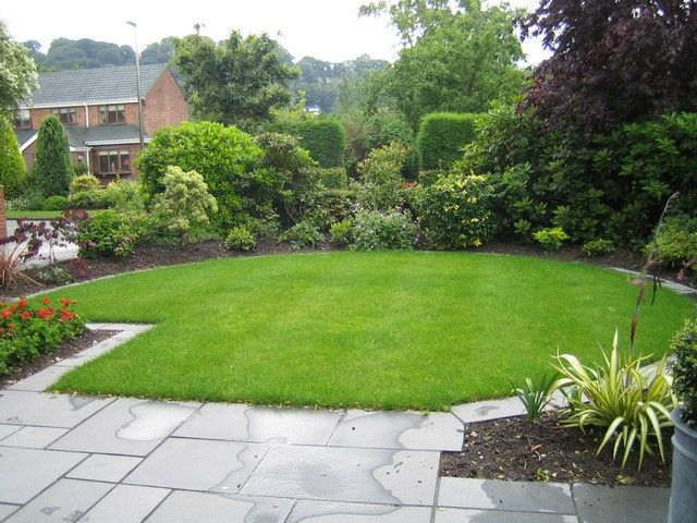 truncated circular lawn blends with straight patio edge