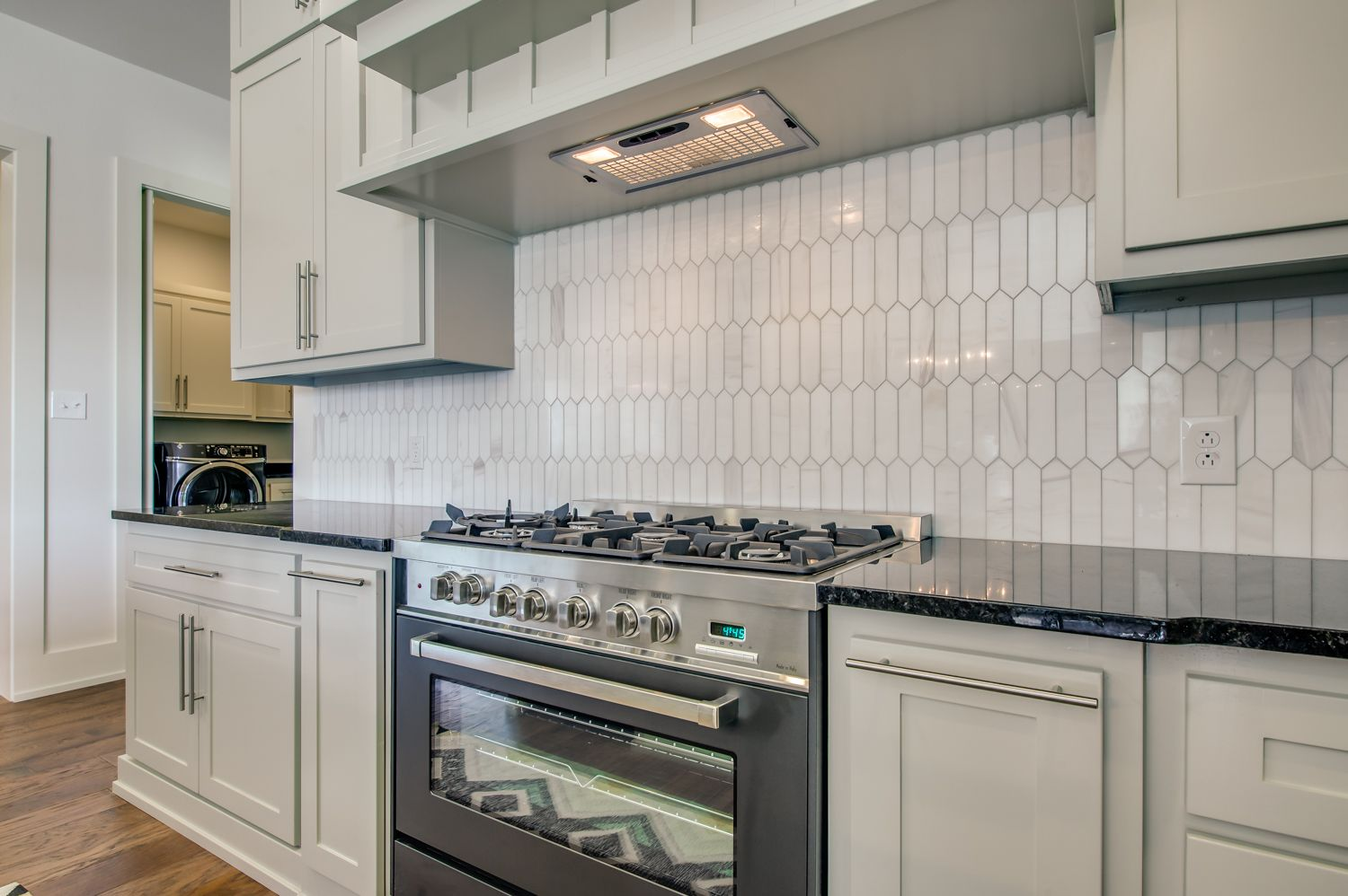 Form And Function Exemplified In The Meeting Of Custom Tile Work And Commercial Grade Appliances Kitchen Dining Room Kitchen Custom Tiles