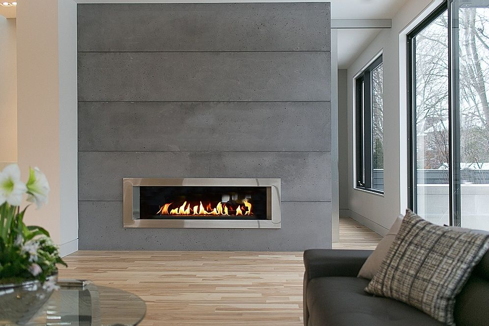 Floor to ceiling lightweight concrete panels by dekko for Grey stone fireplace surrounds