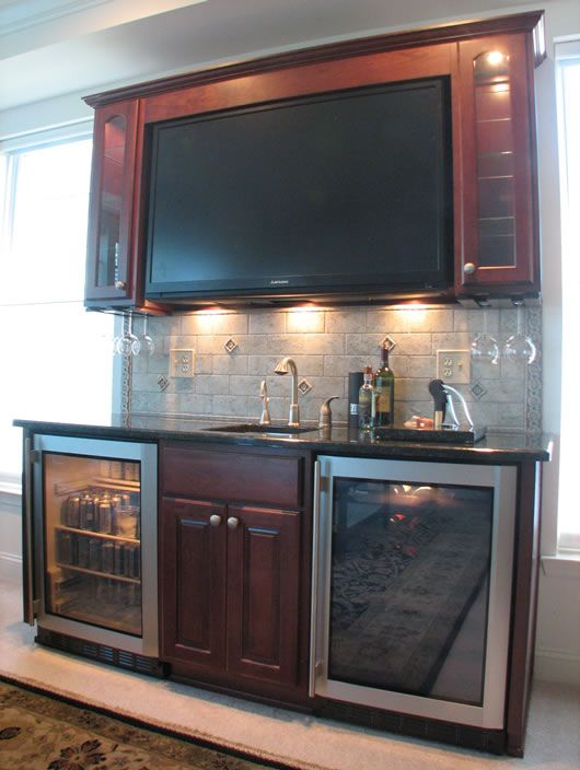 Never Miss An Important Play In The Game Or Part Of The Movie With The Wet Bar Located Under The Big Screen Home Wet Bar Bars For Home Home Bar Designs