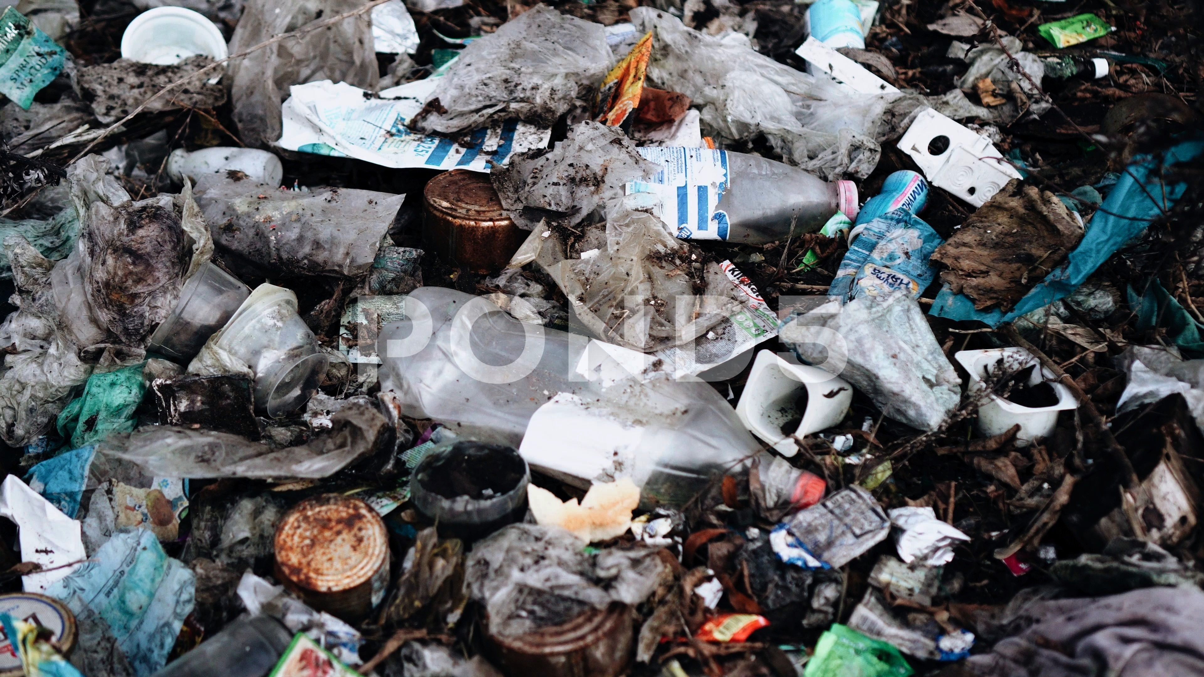 huge pile of garbage right in the city on a vacant lot Pollution of nature cityvacantgarbagehugeA huge pile of garbage right in the city on a vacant lot Pollution of natu...