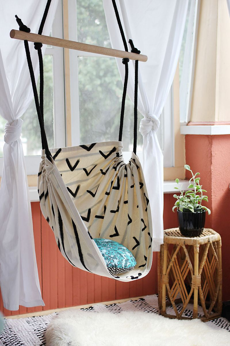 Use a dowel a piece of material and make an indoor hammock