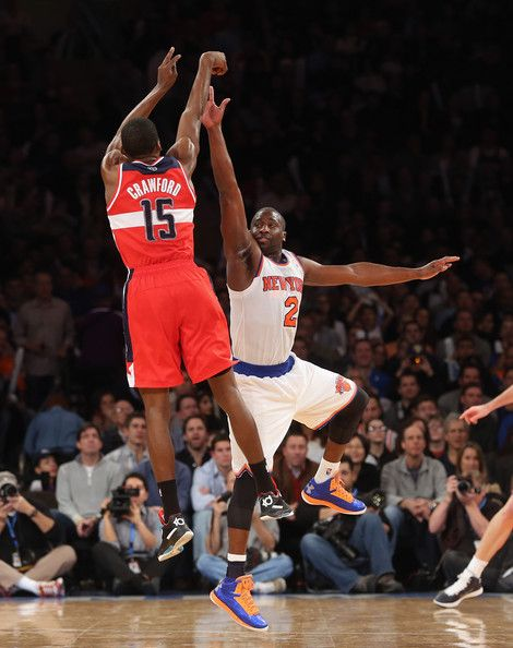 519bf94f6b5d Raymond Felton  2 of the New York Knicks blocks a shot by Jordan Crawford   15 of the Washington Wizards at Madison Square Garden on November 30