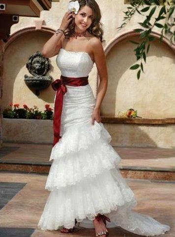 queusar: vestido de novia sirena con volados y lazo rojo