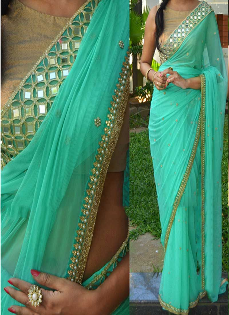 Lehenga blouse design in golden color and mirror work - Designer Saree Is Designed With Georgette Fabric With Stone Work And Mirror Work Patch Border Lace