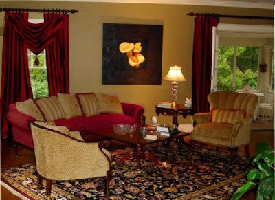 burgundy & gold living room. i like the arrangement of the