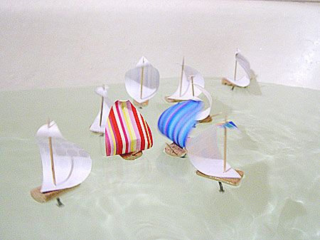 Need colored paper, cork, toothpicks, wood screws for the keel. cut the cork in half and insert half a toothpick in front. Cut out colored paper sails and fasten w/whole toothpick.Screw the screw to bottom for weight. Per Russian Blog through Trueblue tag:diy ragatta. run to the bathroom!
