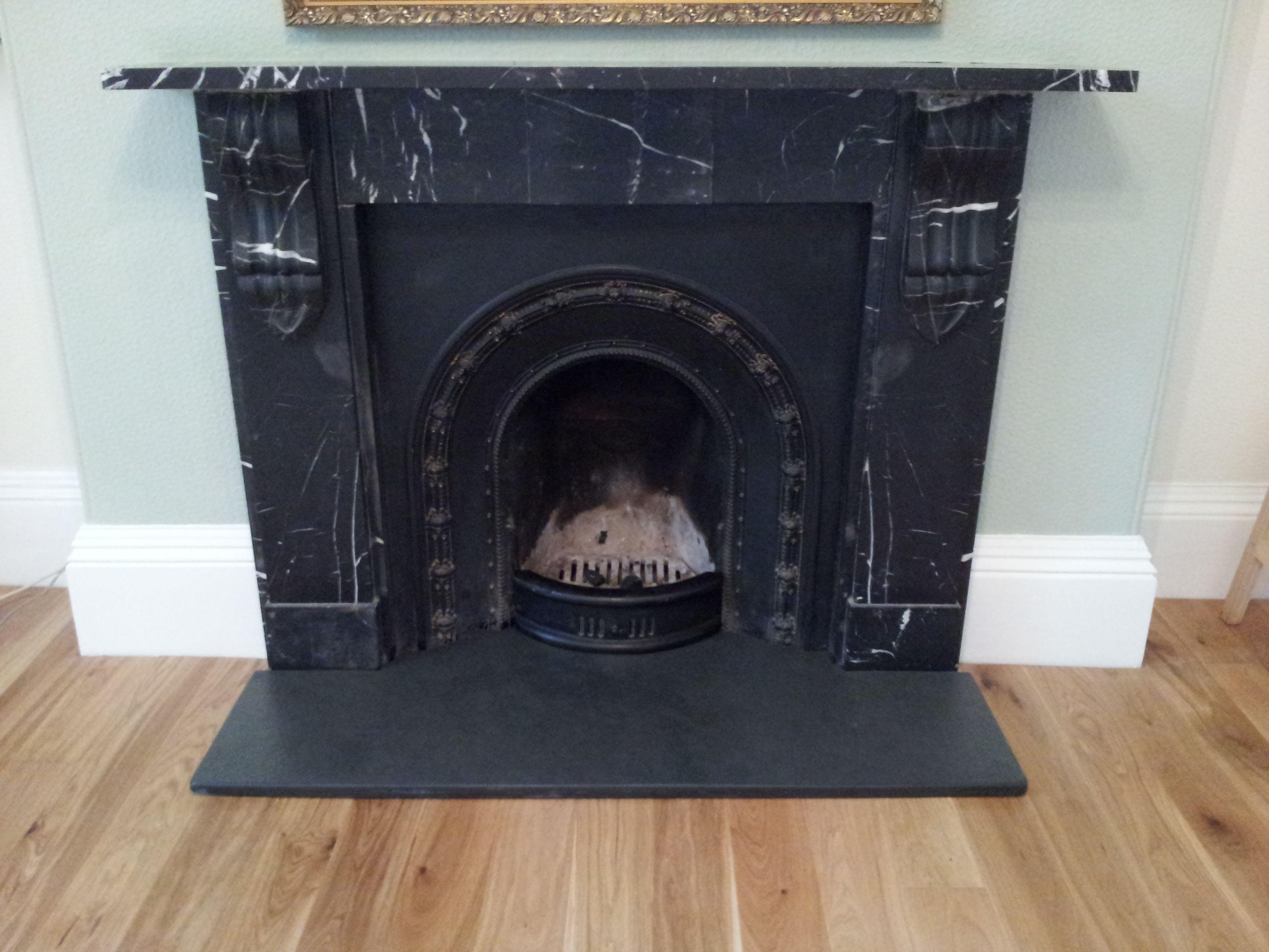A Traditional Fireplace Set On Black Brazilian Black Slate