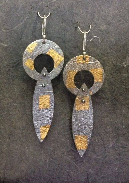 """Sterling silver and 24 K gold earrings. Truly dramatic Kuembu 24k on sterling with original design / texture roll printed onto the surface. The bottom pod snap is articulated, hanging from a """"u"""" shaped wire. 2"""" long. One of a series, limited edition."""