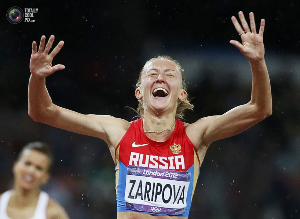 Day 10 - Russia's Yulia Zaripova reacts as she wins the women's 3000m steeplechase final at the London 2012 Olympic Games. LUCY NICHOLSON/REUTERS