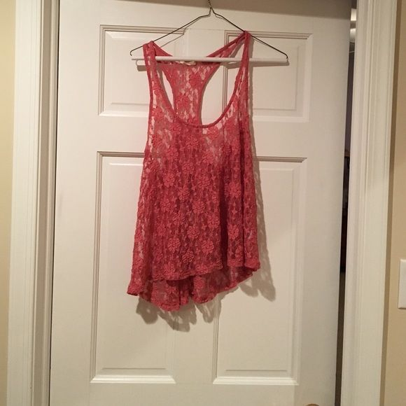 Flowery see through tank top. In great condition. Low front flowery tank top. It's flowy and loose. It is see through. It has a razor back and very comfortable. Tops Tank Tops