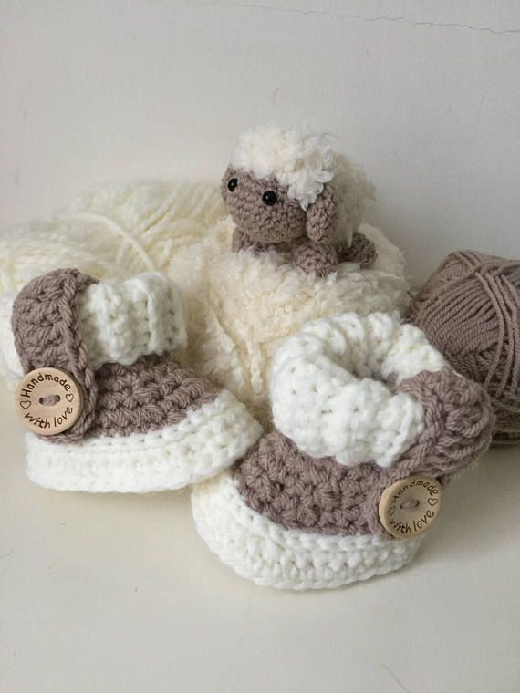 Ugg baby Shoes Model with wooden button and decorative strap ...