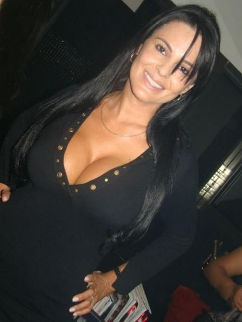 Pretty Mature Latina Woman Image Pretty Latina Long Hair Large Breasts Wearing Black Top