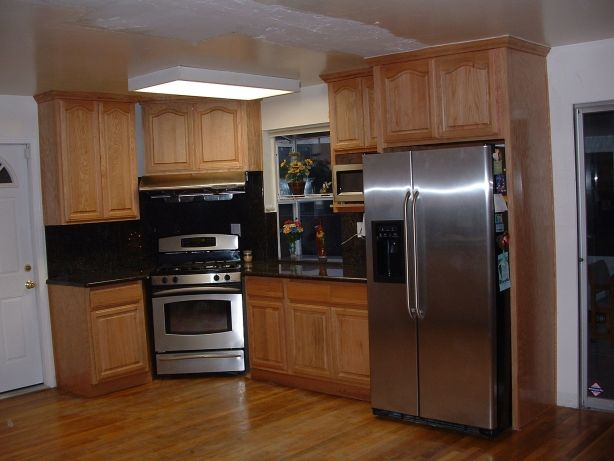 Kitchen Design Oak Cabinets kitchen design with oak cabinets and stainless steel appliances