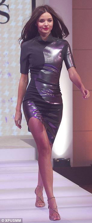 3440659e3e Supermodel Miranda Kerr struts her stuff in designer swimsuits and ...