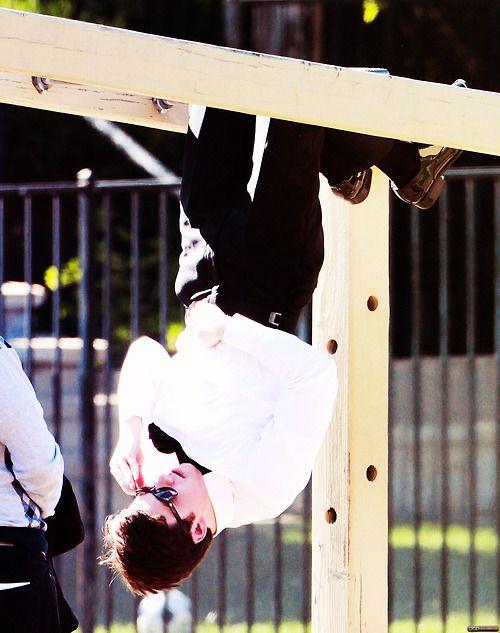 Chris likes to hang upside down