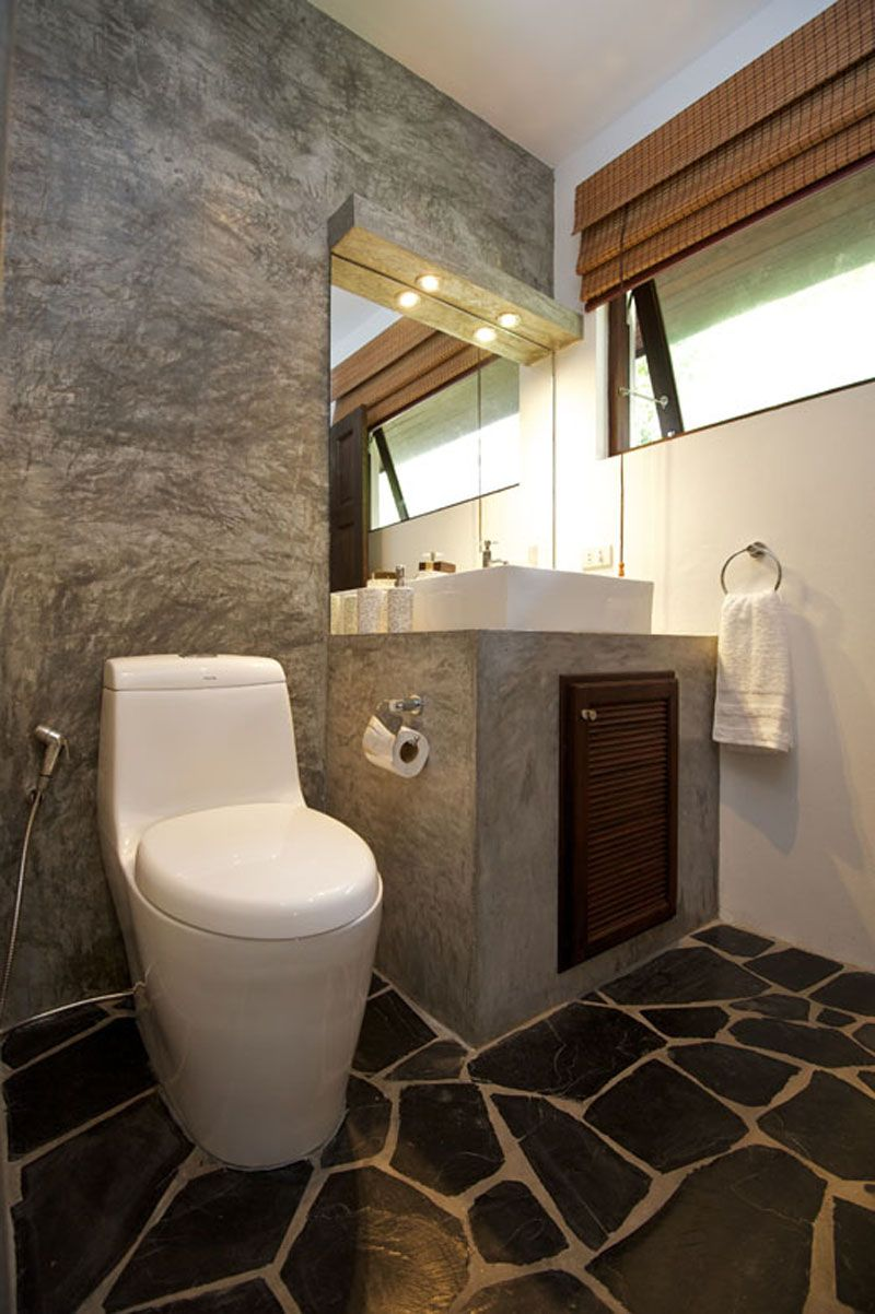 Modern rustic bathroom. Wonderful stone floors create a giraffe ...