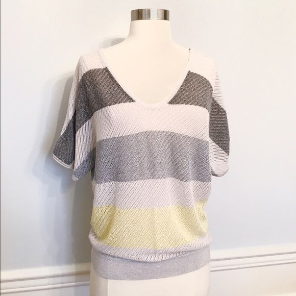 NWT Express colorblock sweater! NWT Express lightweight colorblock sweater! Gold metallic threads stitched through! Grey color blocked! Yellow stripe at the bottom! Perfect for spring time! Price tag not attached but string for it is there! Size medium. Any questions let me know! Express Sweaters V-Necks