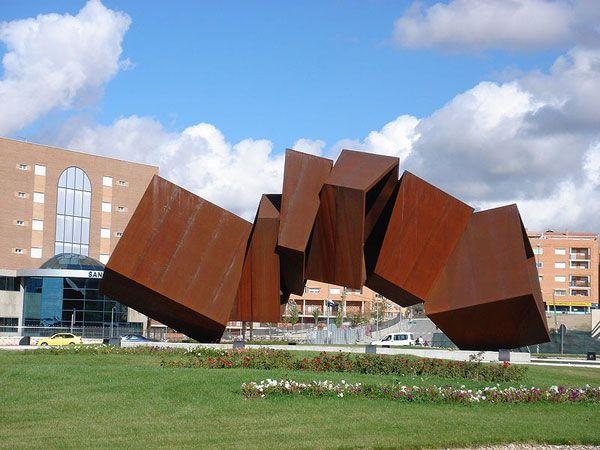 a sculpture made of corten steel in arganda del rey in spain photo credit