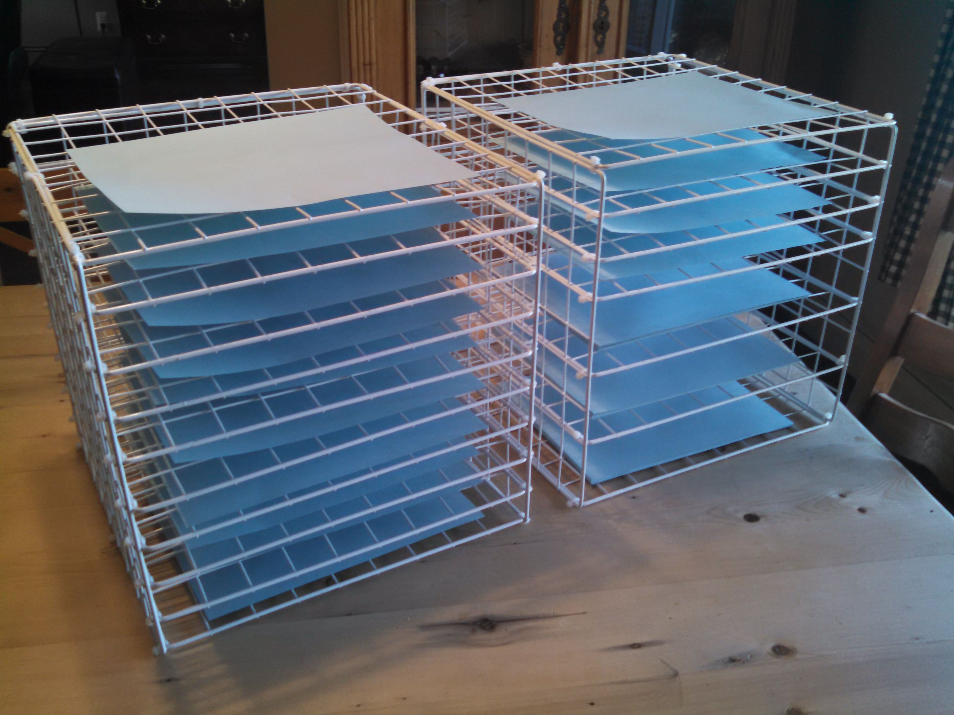 art drying racks shown with papers