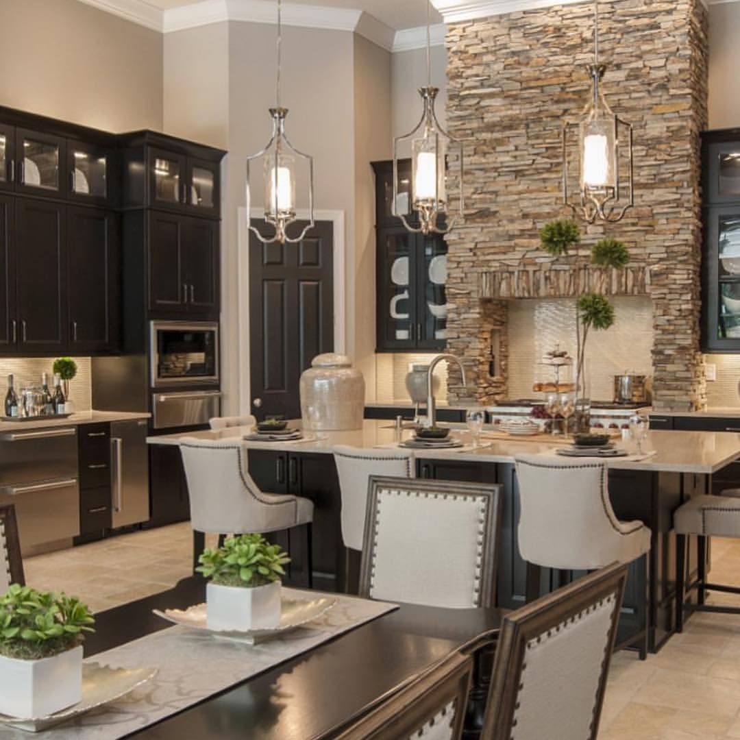 Natural Stone Black Cabinets And High Ceilings What A Lovely Creation Of Masterpiece Design Group Beautiful Kitchens Kitchen Design Kitchen