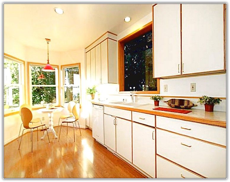white kitchen cabinets with stained wood trim kitchen