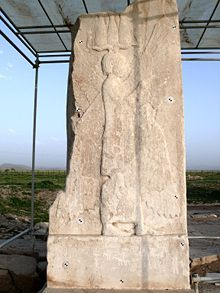 """The four winged guardian figure representing Cyrus the Great, a bas-relief found at Pasargadae on top of which was once inscribed in three languages the sentence """"I am Cyrus the king, an Achaemenian"""