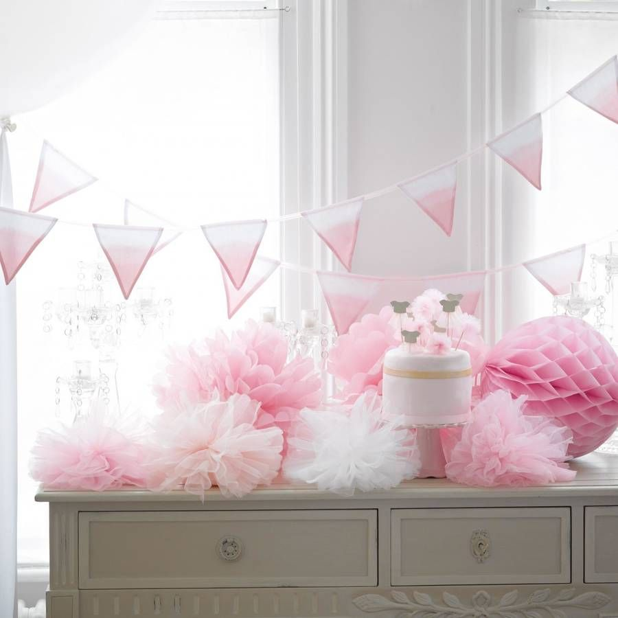 doors pom pom decorations with a large pom pom fruit pink as well as several others