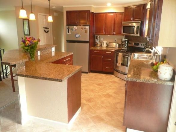 Split Level Kitchen. great idea to engage guests while you continue ...