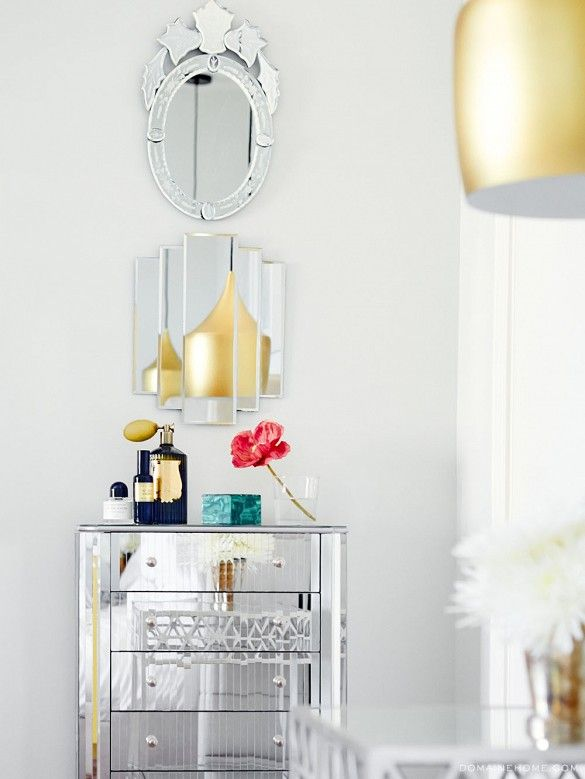 Exclusive: Tour Claire Thomas' Mod House on Stilts via @domainehome // Mirrored cabinet, wall of mirrors.