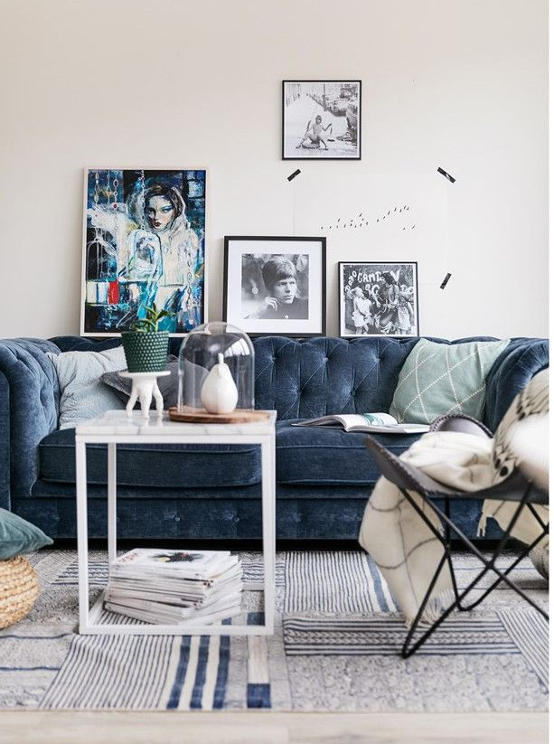 Cadet Blue Velvet Sofa With Modern Art And Leather Erfly Chair Relaxed Living Room That Is