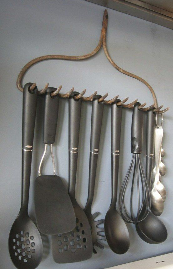 Neat organizational idea! An old rake turned into utensil rack. Would look great in your kitchen & keep them off the counter. I think a little crafty enhancement is due for it to hang in my kitchen.