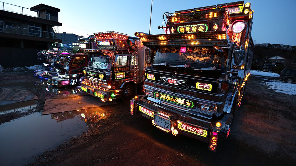 These ornately designed dekotoratrucks line up to show off their beauty. The stylized trucks are unique to Japan and can often be seen at car shows and special events, or even on the road as work trucks. Owners do everything and anything to dress up and trick out their trucks with neon lights and extravagant additions. The end result is something you'd be more likely to see in a Mad Max sequel than on the open highway.