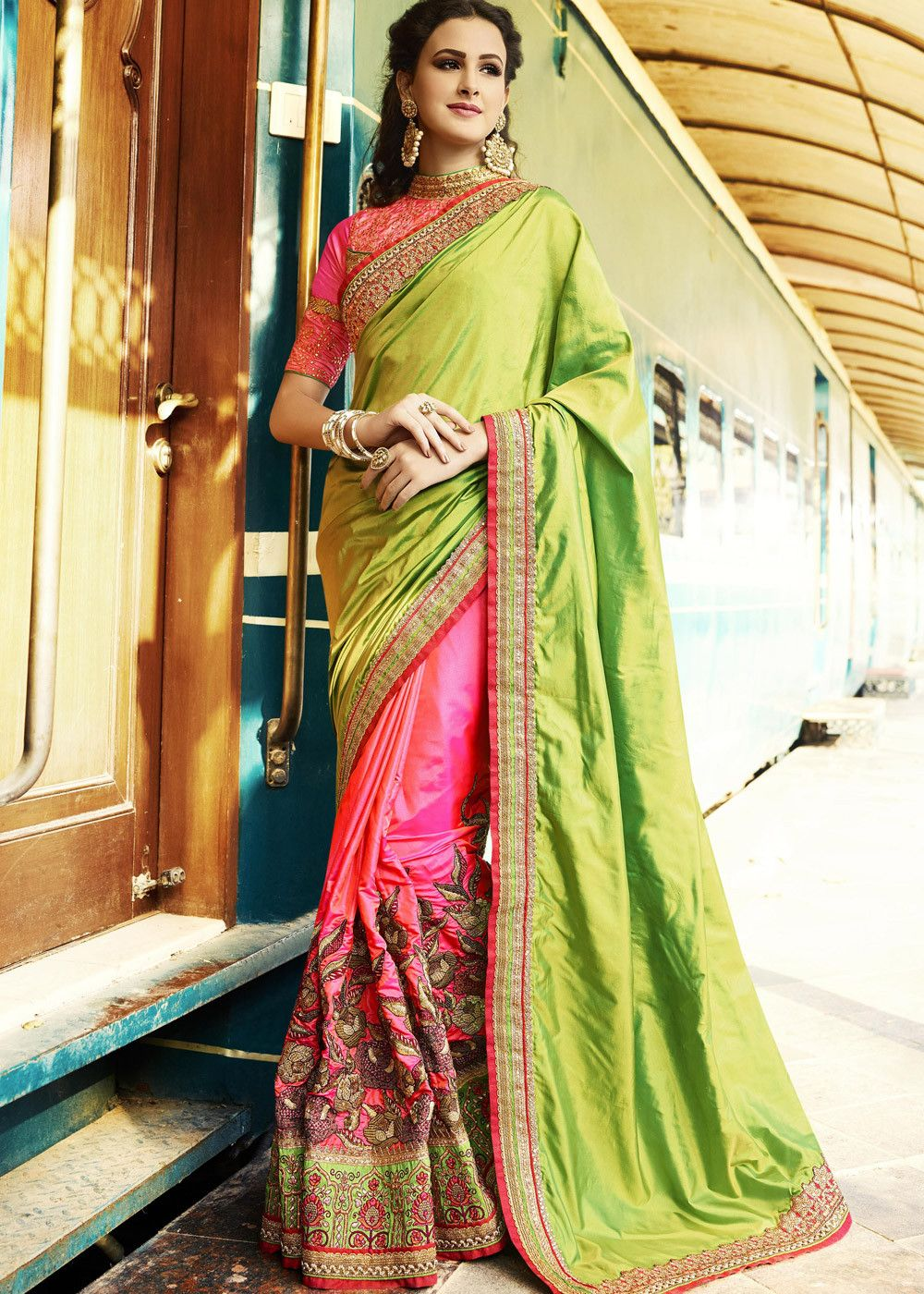 7e3f16f369 Half n half style crepe #silk #saree in #pink skirt and light #green #pallu  enhanced by zari, resham embroidery and stone work throughout.