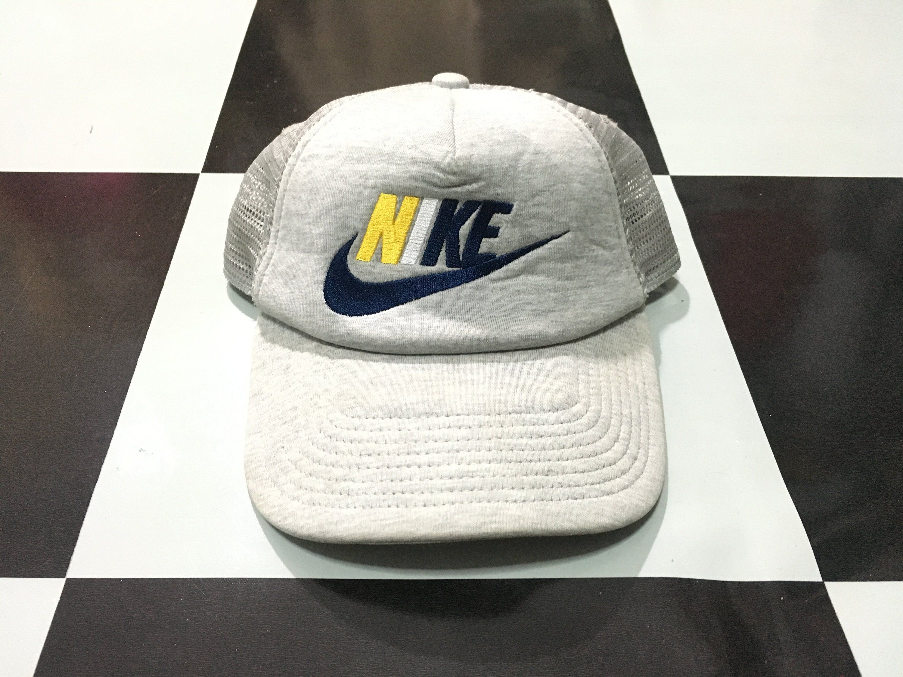 4bc684d681a Vintage Nike cap spell out multi color swoosh logo embroidered trucker cap  Gray 90s Nike gray tag Excellent condition by AlivevintageShop on Etsy