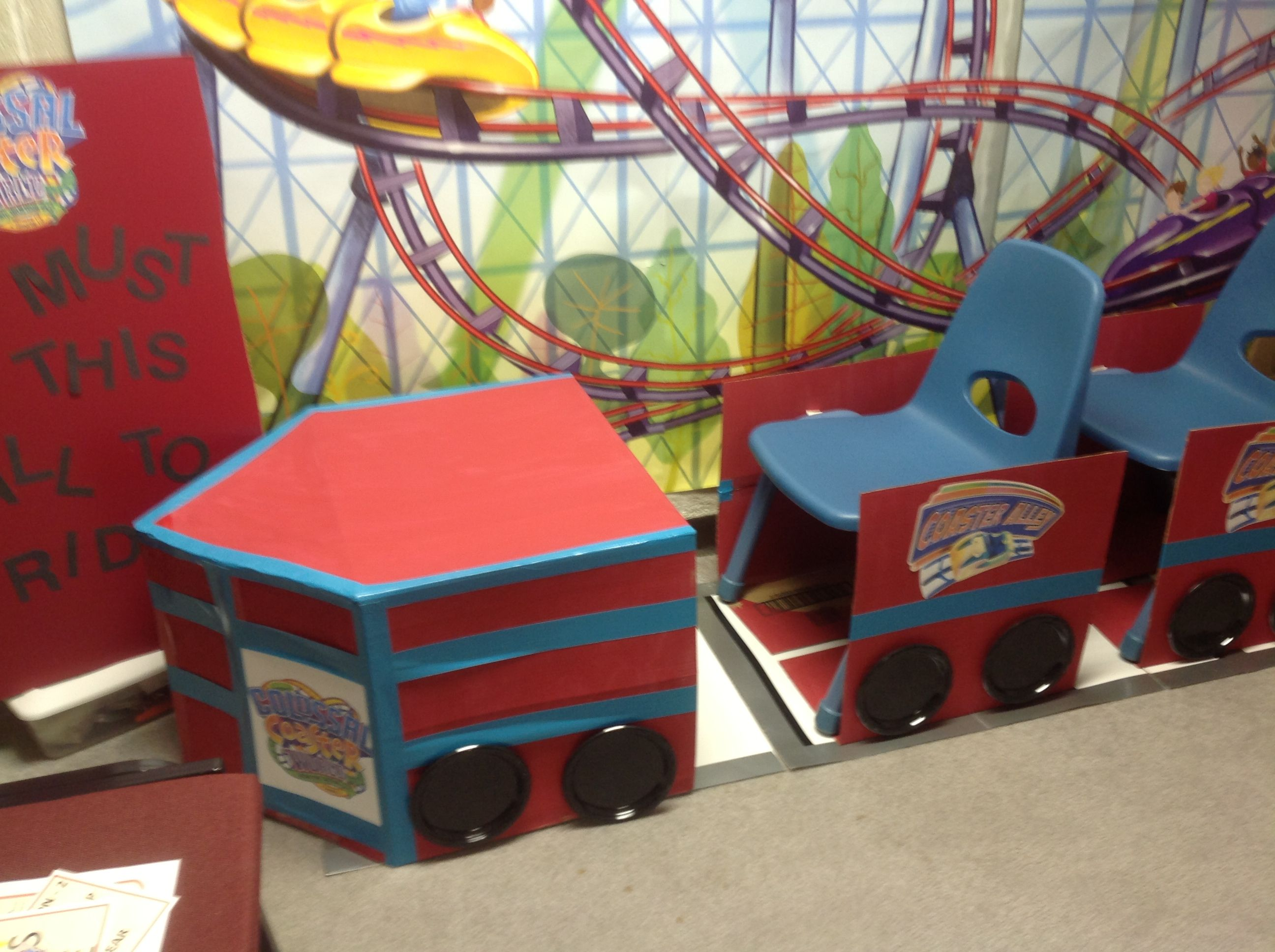 Boxes Painted And Taped To Look Like Roller Coaster Cars