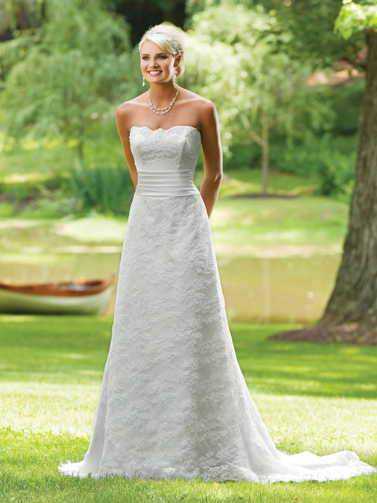 Scalloped lace wedding dress with cummerbund