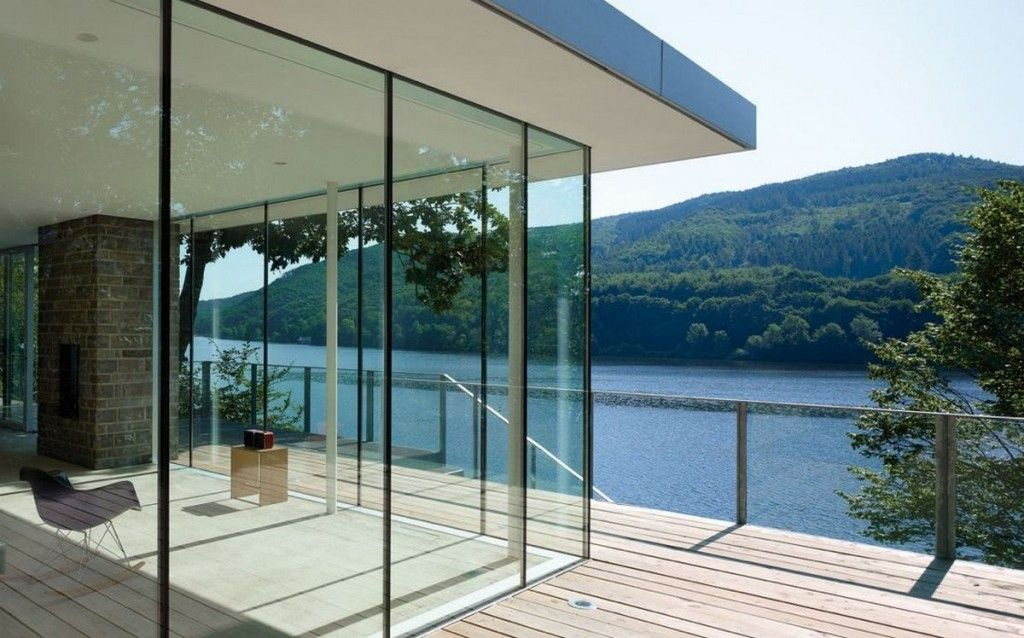 Modern Exterior Design Ideas With Glass Wall Panels Around The Corner And Opens The Living