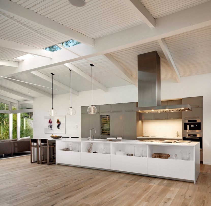 Our hand blown glass stamen pendant lights hang above this kitchen island in a california