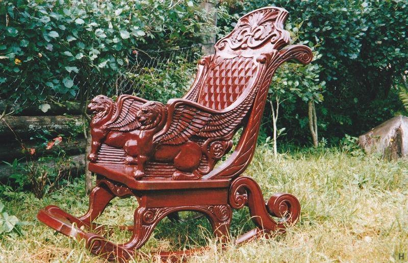 Резное кресло-качалка купить недорого в интернет магазине товаров ручной работы  HandClub.ru  Кресло-качалка выполнено из массива дуба, подлокотники сделаны в форме львов. Дуга качания составляет 30 см. Прекрасно подходит для отдыха перед камином. На заказ.