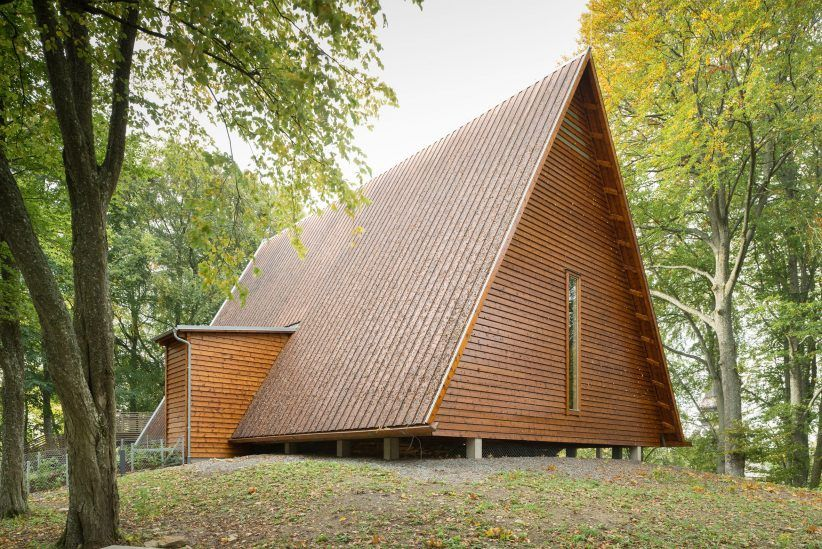 Triangular timber roof shelters the ruins of Sweden's