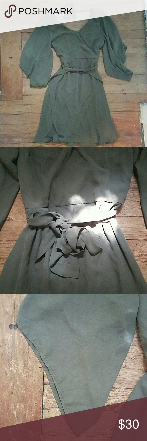 Kimono sleeve dress Olive green kimono sleeve dress with a tie waist, zipper back, and open v back with a tie that goes across the neck. Never worn, tags still on. Dresses