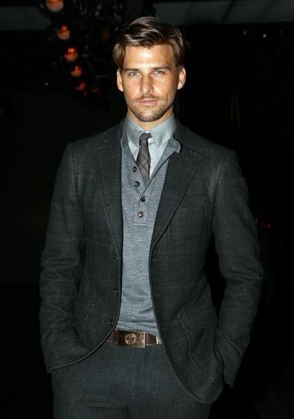 Dark gray blazer w/ light gray sweater underneath. The ...