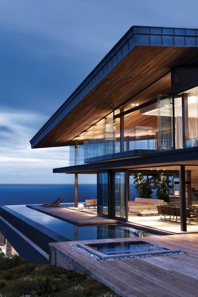 Beachfront Luxury Modern Home Exterior At Night: Striking Clifftop Home In The Cove At Pezula Estate